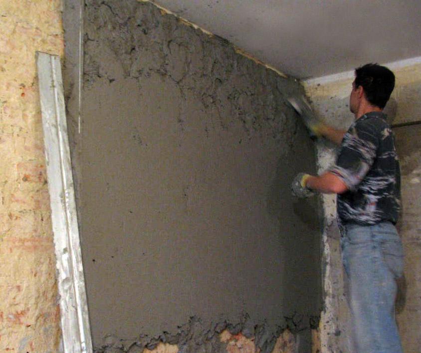 Перед поклейкой обоев кирпичную стену тщательно штукатурят